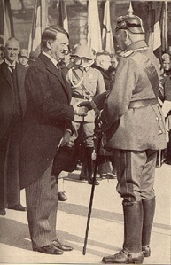 Hitler receiving the Chancellorship from President Hindenberg.