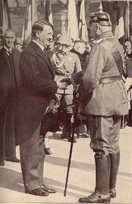 Hitler receiving the Chancellorship from President Hindenberg.